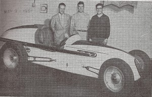 George Leitenberger, Roy Sherman and Francis Leitenberger, left to right, stand behind the car they groomed for the 1951 Indianapolis 500 race. The Johnstown automobile dealers financed the construction of the all-aluminum mount. Sherman was a driver on the team.