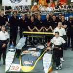 A team shot of the No. 32 Roock-Knight Hawk Lola Nissan that Chris Gleason, Rick Fairbanks and Claudia Hurtgen drove at the 24 Hours of Le Mans in Le Mans, France in 2001. Gleason is at left in foreground. The entry finished fourth in the LMP675 class.