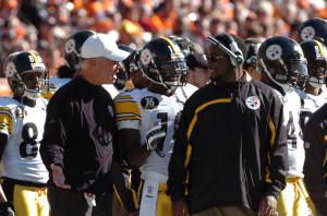 Dr. James P. Bradley, left, speaks to Steelers coach Mike Tomlin
