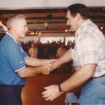 Frank Kush, left, and Pete Duranko shake hands during a Windber Centennial celebration in 1997.