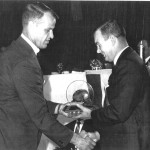 Hockey legend Gordie Howe presents hall of fame award to Don Hall in 1965.