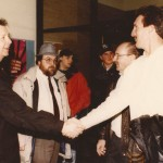 Former Conemaugh Township High School boys basketball coach Scott Cable shakes hands with Jeff Hostetler at the 1997 Chupek charity hoops game at Shade High School. Johnstown Tribune-Democrat sports writer Joe Gorden is in the center awaiting an interview.