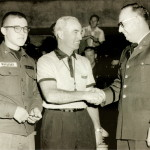 Hugh Conrad, official, meets with U.S. Servicemen