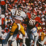 WVU quarterback Jeff Hostetler prepares to pass against Oklahoma.