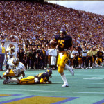 Jeff Hostetler scores a touchdown against rival Pitt in 1983.