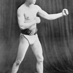 John T. McGovern strikes a bare-handed boxing pose.