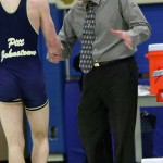 Pat Pecora  coaches a Mountain Cats wrestler.