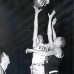 Paul Schmidt, left, takes a shot for Duke University.