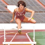 Tammy Etienne clears the hurdles while competing for the University of Texas.