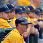 Randy Mazey watches with his team from the WVU dugout.