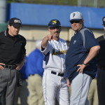 Randy Mazey talks to the umpire and Pitt coach.