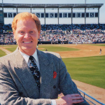 Tom McGough broadcaster at a minor league park.