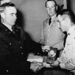 Fran Urban on right receives medal in Germany Sept 1960