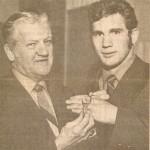 Rec Commission Chairman John Blackburn presents Gene Pentz his 1970 Point Stadium Award watch.