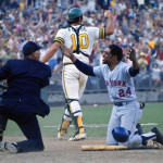 Augie Donatelli listens as New York Mets outfielder Willie Mays pleads his case after a call at home plate. Oakland catcher Ray Fosse is in the background.
