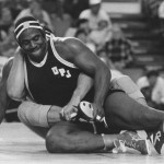 Haselrig works over an opponent on the mat.