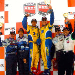 Chris Gleason (third from right) and his teammate, Bill Auberlen (fourth from right) celebrate a victory in the Grand Am Koni Challenge GS race at the Grand Prix of Trois-Rivieres in Trois-Rivieres, Quebec on Aug. 19, 2007.