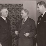 NHL President Clarence Campbell, left,  Eastern Hockey League President Tom Lockhart, middle, and Charles Kunkle Jr., right.