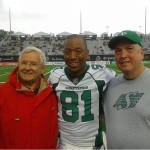 Jerry Davitch, left, with CFL record-breaking receiver Geroy Simon, middle, and Tom Fleming, at a Saskatchewan Roughriders game. All three men are Johnstown High graduates. Davitch and Fleming each coached the Trojans football team.