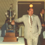 Don Hall, poses with the 1975 NAHL Lockhart Trophy. Hall was president of the team.