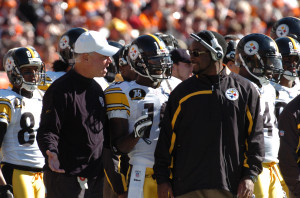 Dr. James P. Bradley, left, speaks to Steelers coach Mike Tomlin