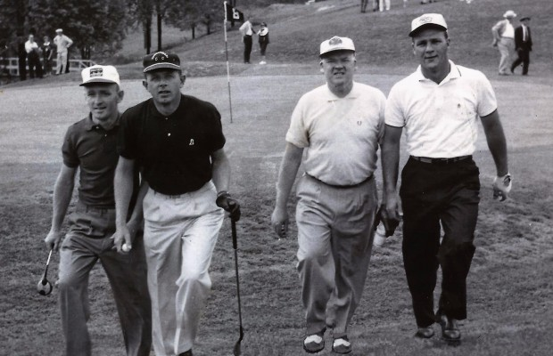 Goettlicher left and Arnie Palmer right with group
