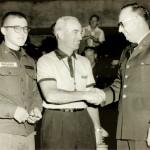 Hugh Conrad, official, meets with U.S. Servicemen