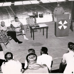 Hugh Conrad (seated) at introduction to the officiating clinics that he presented in Alaska as part of a U.S. Army program conducted through the Defense Department.