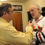 Jack Ham supported hockey in his hometown by becoming a minority owner in the NAHL's Johnstown Tomahawks. Here he is interviewed by Tribune-Democrat sports writer Mike Mastovich on Jack Ham bobblehead night in 2013.