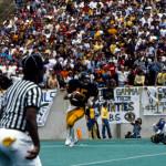 WVU's Jeff Hostetler rolls out against Pitt in 1983.