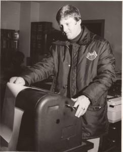 John Hubbard reads the teletype copy.