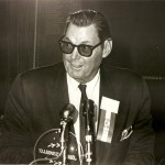 Johnny Weissmuller accepts hall of fame plaque