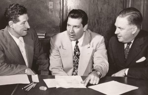 Nat Hickey, left, talks business with McWilliams, center, and Williams, right in December 1949.