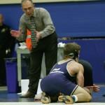 Pat Pecora watches his wrestler make a move.