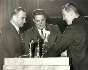 Ron Kostelnik, center, accepts his 1967 hall of fame induction plaque.