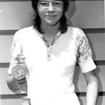 Tammy Etienne holds a medal at Portage High School, where she set school records.