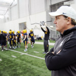 Tom Bradley oversees a drill at a WVU practice.