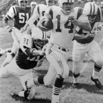 Boston Patriots QB Tom Yewcic runs past New York Jets defenders in an AFL game.