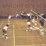 Leah Hollis, foreground, prepares for a volley while playing for Rutgers University.