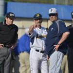 Randy Mazey talks to the umpire and Pitt coach.