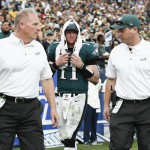 Philadelphia Eagles quarterback Carson Wentz walks off the field after being injured. Chris Peduzzi is to his right.